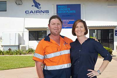 Shaun and Kym Cairns in front of Cairns Industries building