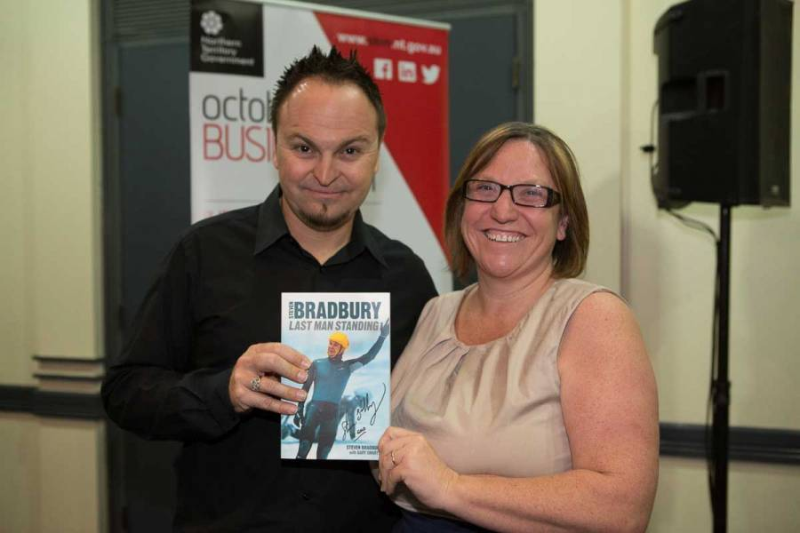 Steven Bradbury presenting prize winner with his book